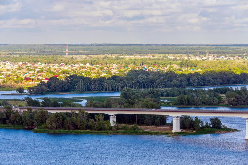 View of hills and steppe and a modern bridge over upper river Don in Russia. Background, beautiful, blue, bright, calm, coast, construction, cossacks stock images