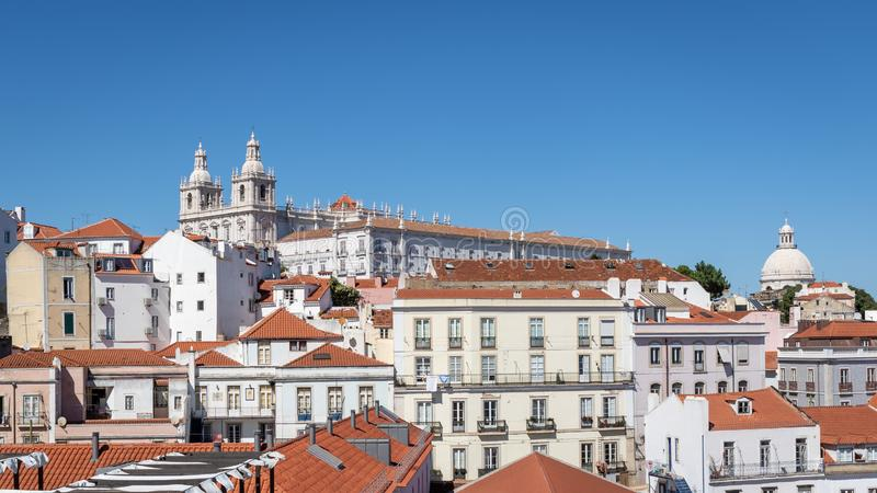 View of historic Alfama district in Lisbon, capital of Portugal on a sunny day. Church and monastery of Sao Vicente of Fora on the. Top of a hill stock photography