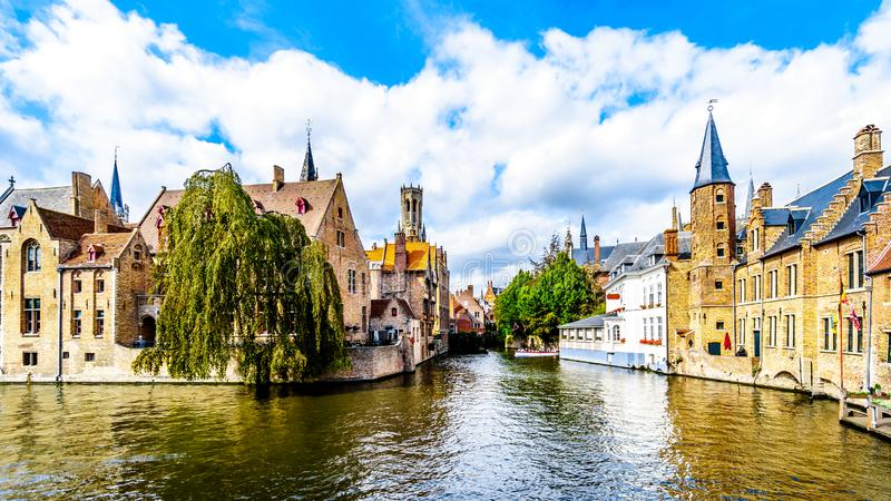 View of the historic buildings and the Belfort Tower from the Dijver canal in the city of Bruges, Belgium. View of the historic buildings and the Belfort Tower stock photos