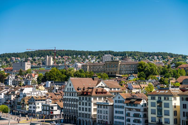 View of the historic center of Zurich at the bank of Limmat River, with beautiful house rooftops and main building of ETH , view stock images