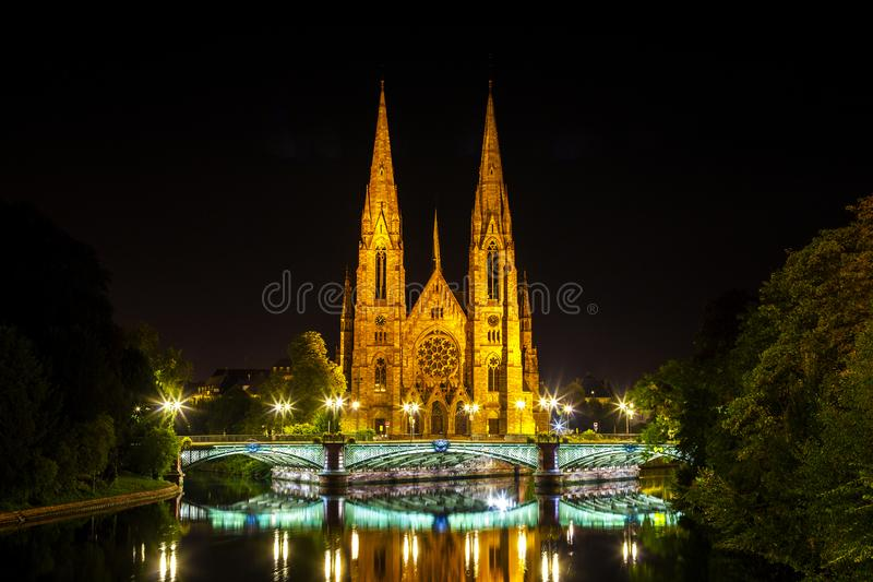 View at the historic church of Saint Paul with the river Ill in Strasbourg at night,. Alsace, France royalty free stock photos