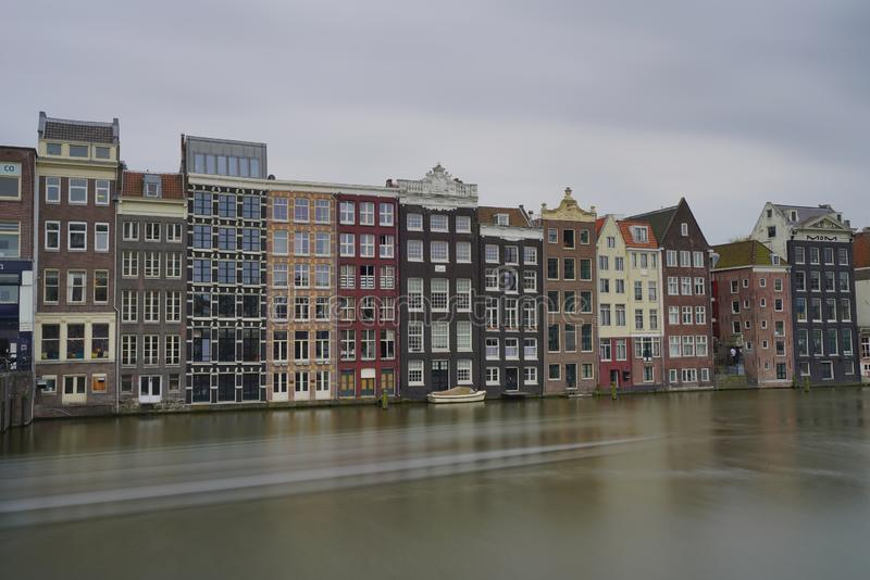 Houses along rederij plas amsterdam canals. A view of historic houses in front of rederij plas alongside Amsterdam canals royalty free stock photo