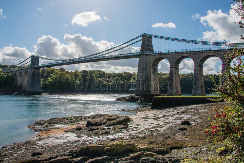 A view of the historic Menai suspension bridge spanning the Mena. I Straits, Gwynnedd, Wales, UK stock image