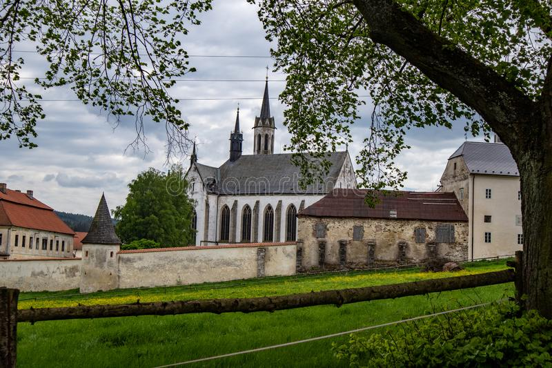 View from the historic monastery Vyssi Brod. In the Czech Republic with historic buildings, churches and narrow streets in front of blue sky stock photography