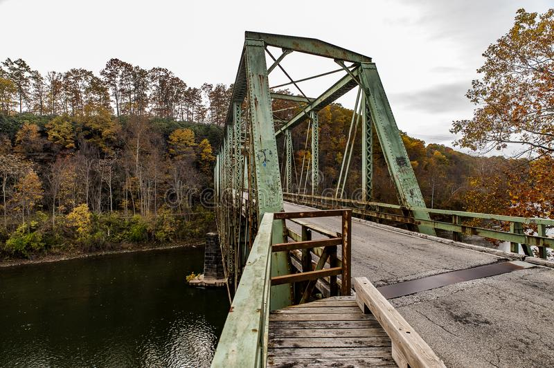 Historic Green Truss Bridge in Autumn - Layton Bridge - Fayette County, Pennsylvania. A view of the historic, narrow, one lane green truss Layton Bridge on an royalty free stock photography