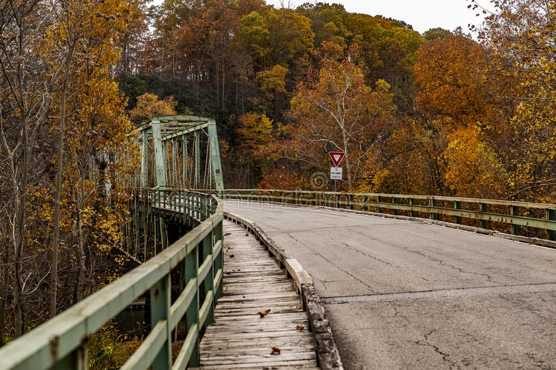 Historic Green Truss Bridge in Autumn - Layton Bridge - Fayette County, Pennsylvania. A view of the historic, narrow, one lane green truss Layton Bridge on an royalty free stock image