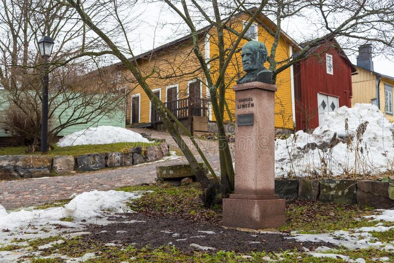 View of the historic Old Town, Vanha Porvoo, and statue of Gabriel Linsen, Finland. Porvoo, Finland- 04 March 2015: View of the historic Old Town, Vanha Porvoo royalty free stock images