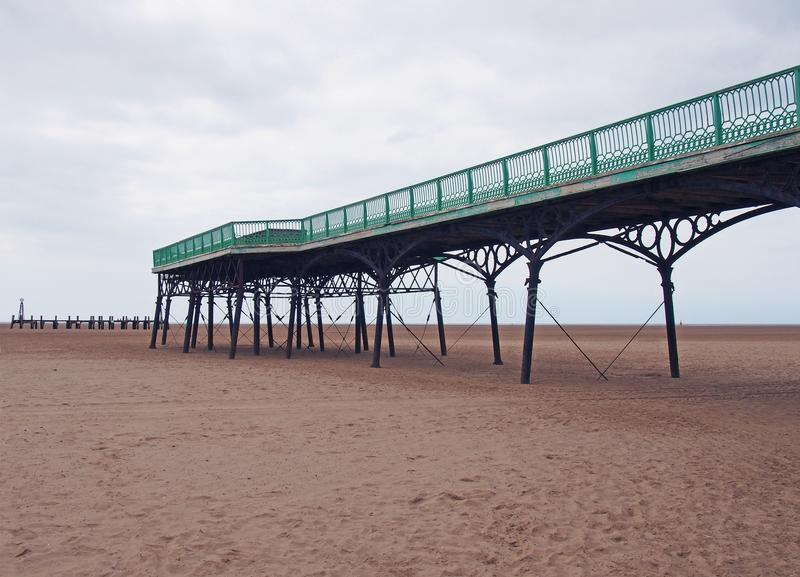 View of the historic victorian pier at saint annes on sea in in lancashire with the beach at low tide looking out to sea. A view of the historic victorian pier stock photos