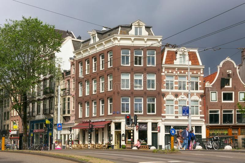 AMSTERDAM, NETHERLANDS - JUNE 25, 2017: View of the historical buildings on the Prinsengracht and Rosengracht street. View of the historical buildings on the royalty free stock photos