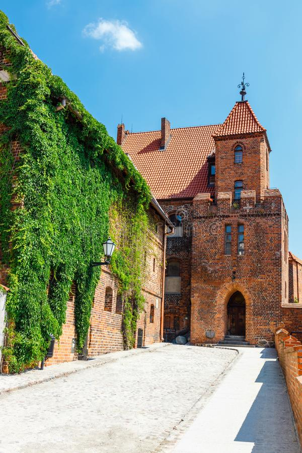 View of historical buildings in Torun in Poland. Torun is listed among the UNESCO World Heritage Sites. View of historical buildings in polish medieval town stock images