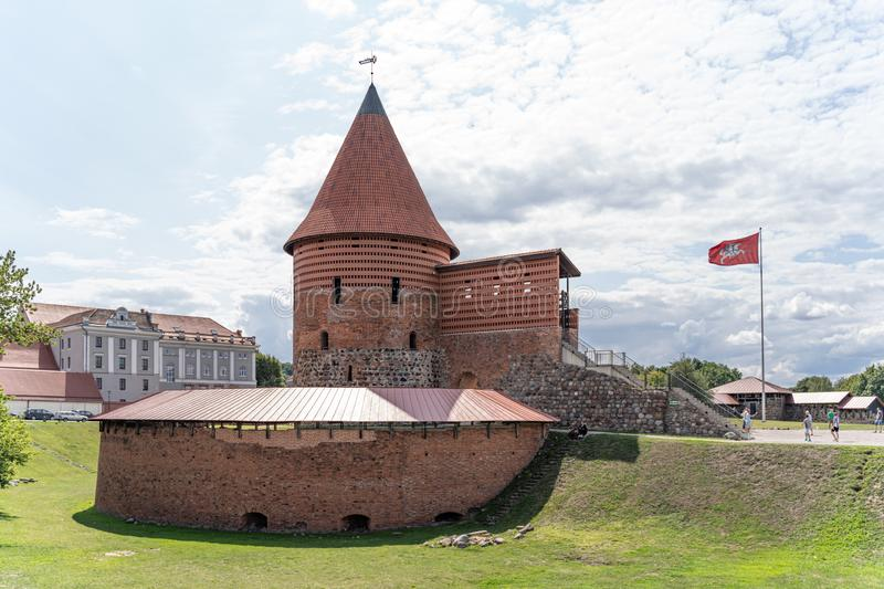 View of historical gothic Kaunas Castle from medieval times in Kaunas, Lithuania. On beautiful blue sky background. Old castle in stock photo
