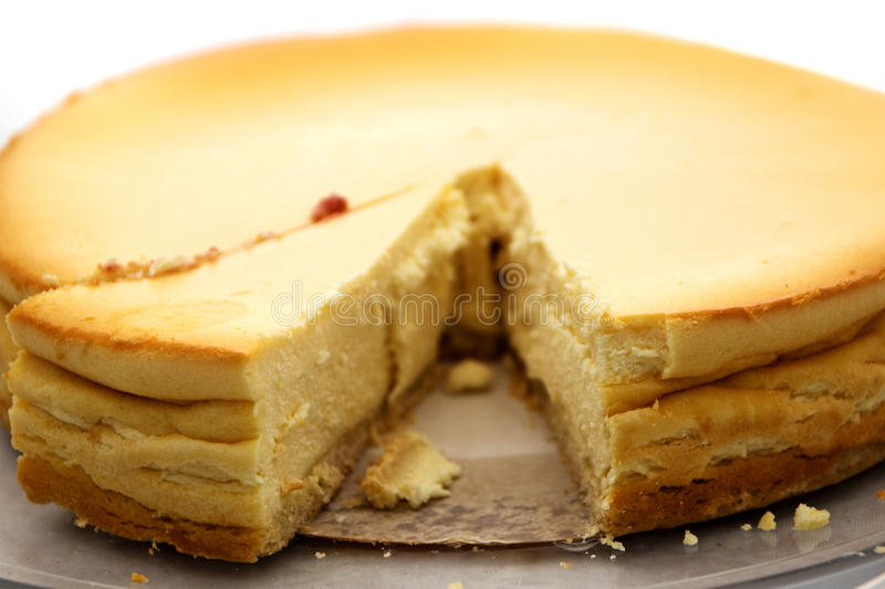 view in a homemade cheesecake with a sliced piece, unusual perspective with very narrow depth of field royalty free stock photos