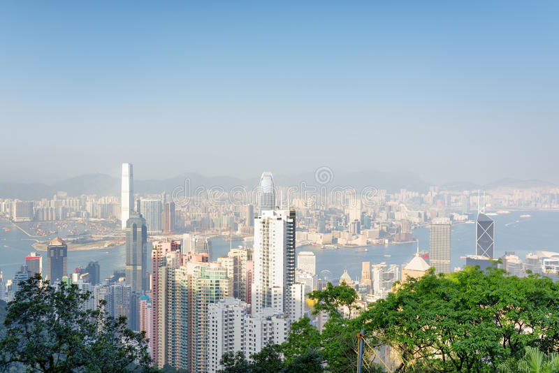 View of Hong Kong city and Victoria harbor from the Victoria Pea. K on a sunny day. Hong Kong is popular tourist destination of Asia and leading financial centre royalty free stock photos