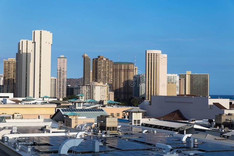View of Honolulu city downtown with high buildings and shopping center roof. Hawaii royalty free stock images