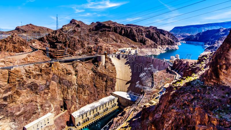 View of the Hoover Dam from the Mike O`Callaghan–Pat Tillman Memorial Bridge. View of the Hoover Dam, a concrete arch dam in the Black Canyon of stock photography
