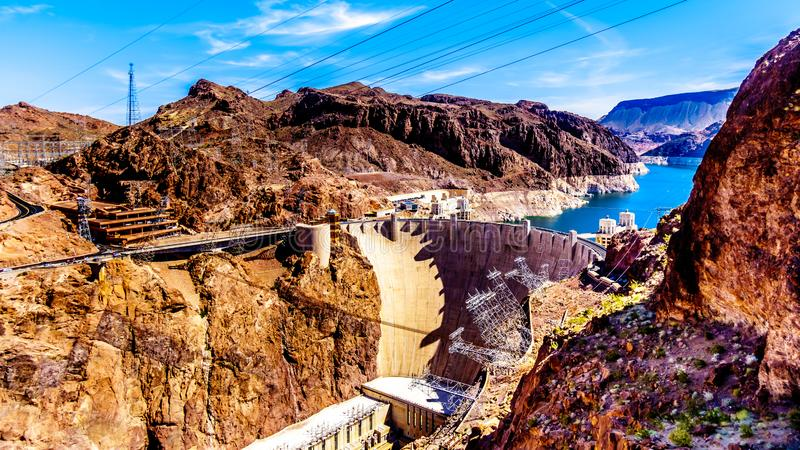 View of the Hoover Dam from the Mike O`Callaghan–Pat Tillman Memorial Bridge. View of the Hoover Dam, a concrete arch dam in the Black Canyon of the royalty free stock image
