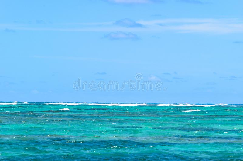 View of horizon line with summer sky and blue turquoise ocean water. View of horizon line with summer sky and blue turquoise ocean water royalty free stock photo
