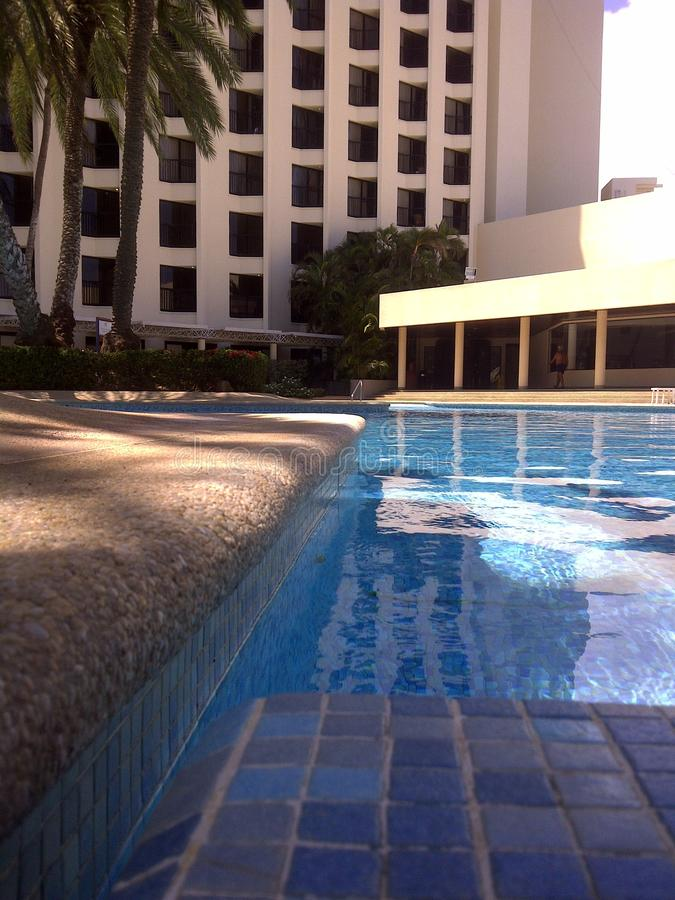 View of hotel from pool edge in tropical Venezuela. Country vacation vacationers tourists tourism trip water blue sun relax rest royalty free stock photo