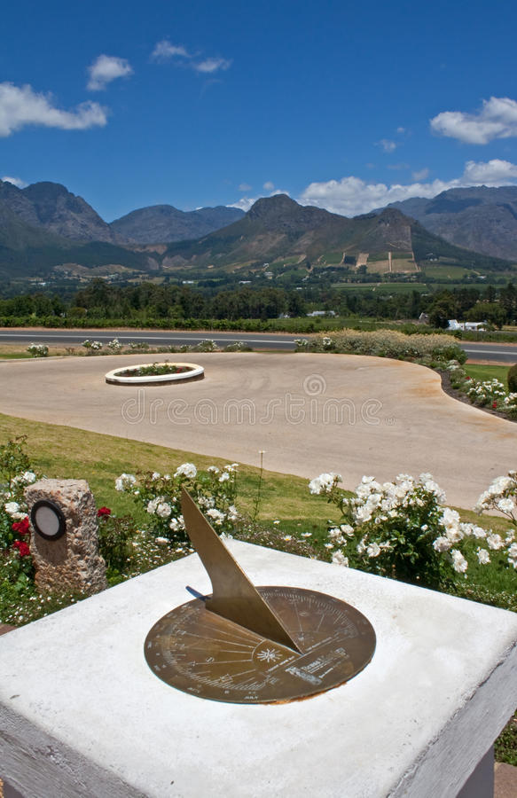 View of the Hottentots-Holland mountains and vineyards from a sundial in Franschhoek. Western Cape, South Africa stock images