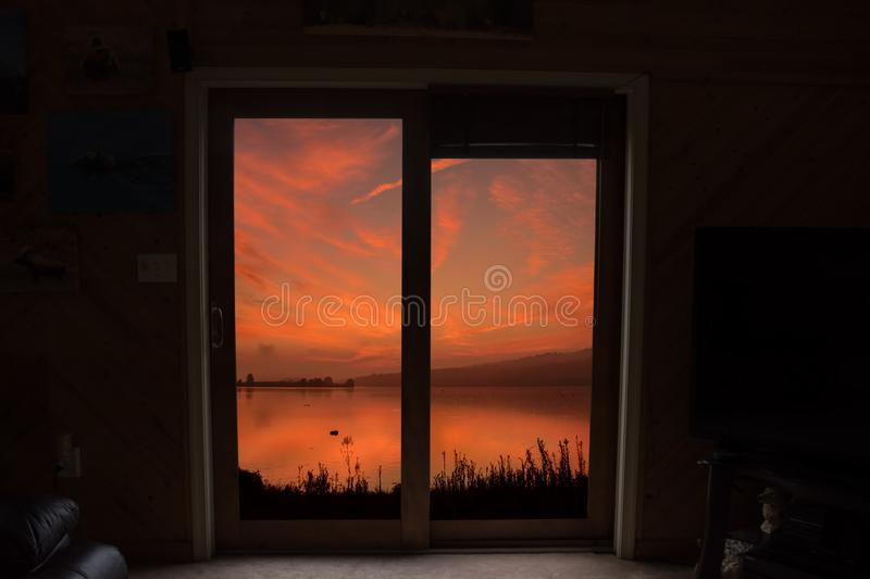 View from a house by the lake at sunrise royalty free stock image