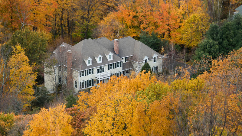 View of the house with mountain views. Autumn in stock photos