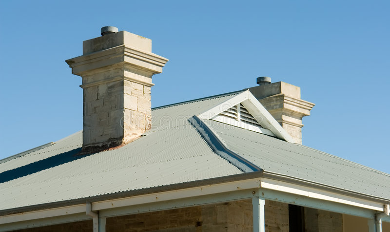 View of house roof line with view to blue sky stock photography