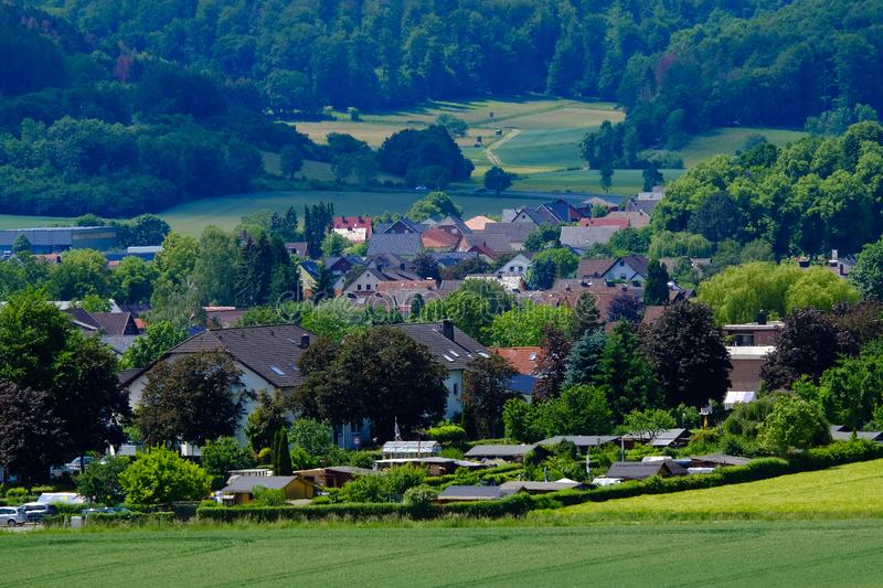 View on the houses and the agricultural fields in Bad Pyrmont, Germany. View on the houses and the agricultural fields with various types of grain in Bad Pyrmont stock image