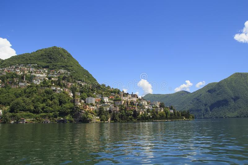 View of the houses of Lugano from the ship. Lake Lugano, Ticino,. Switzerland stock photos