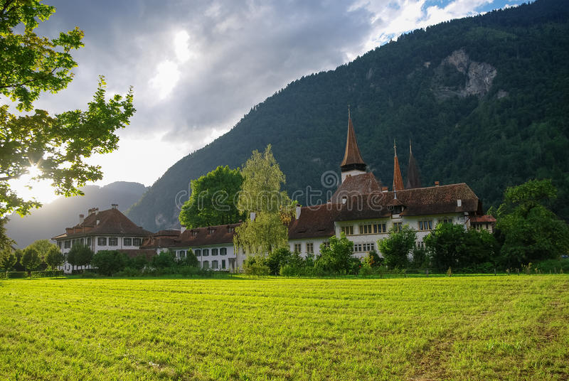 View of houses of old town and Brienz Church in sunset, Interlaken, Switzerland royalty free stock images