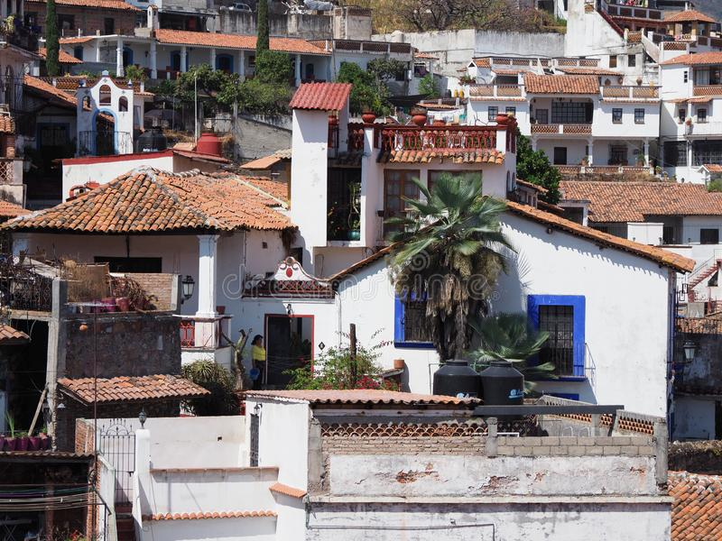 View of housing estate at cityscape landscape of historical Taxco city with palm trees, Mexico royalty free stock photography