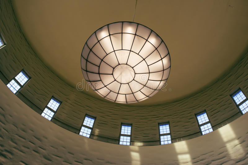 View of huge, beautiful ceiling lamp royalty free stock image