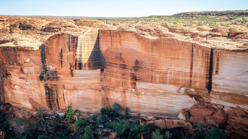 View of the huge cliffs walls of Kings Canyon in NT outback Australia. View of the huge cliffs walls of Kings Canyon in Northern Territory outback Australia stock photo