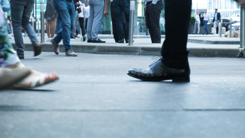 View of human feet people walking on crowded street movement of life people variety pedestrian active walk city life. Urban many legs shoes traveling persons royalty free stock photos
