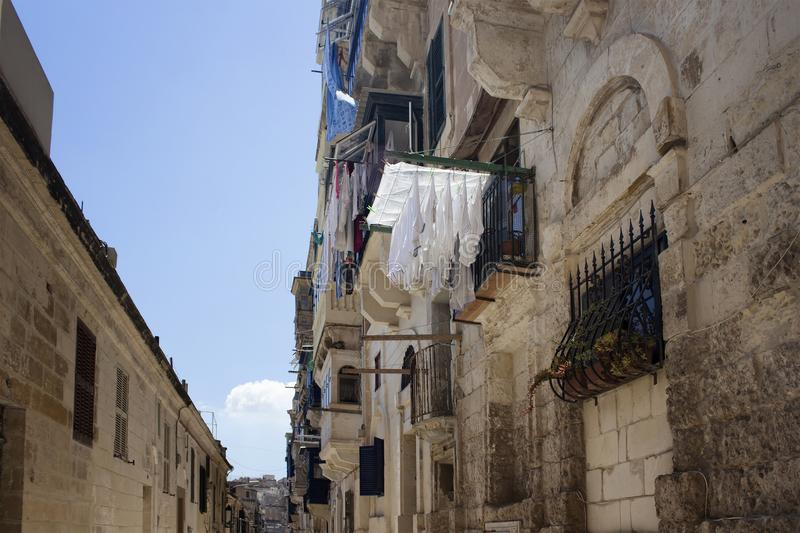 View of hung, washed clothes and buildings stock photography