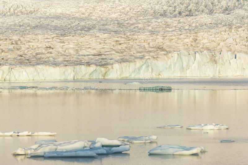 Ice floes floating on the lake, glacier in the background, Iceland stock images