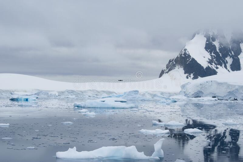View of icebergs in Antarctic peninsula, Antarctica. Global warming and climate change concept royalty free stock photography