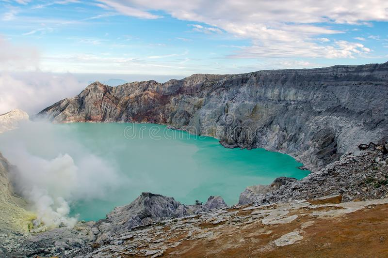 View from Ijen Crater, Sulfur fume at Kawah Ijen, Vocalno in Indenesia. Adventure asia beautiful blue east java foggy gas hard indonesia lake landmark landscape stock photography