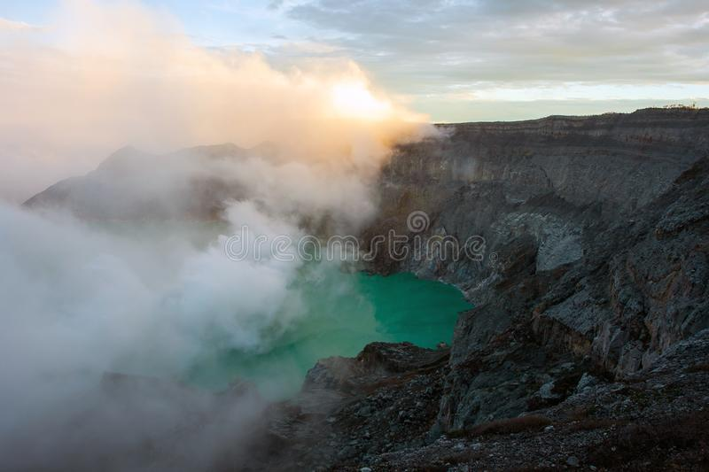 View from Ijen Crater, Sulfur fume at Kawah Ijen, Vocalno in Indenesia. Adventure asia beautiful blue east java foggy gas hard indonesia lake landmark landscape royalty free stock photo