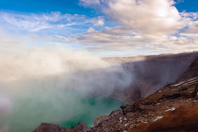 View from Ijen Crater, Sulfur fume at Kawah Ijen, Vocalno in Indenesia. Adventure asia beautiful blue east java foggy gas hard indonesia lake landmark landscape royalty free stock images