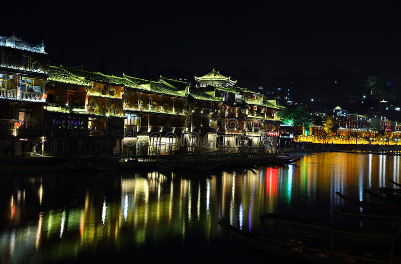 view of illuminated riverside houses in fenghuang