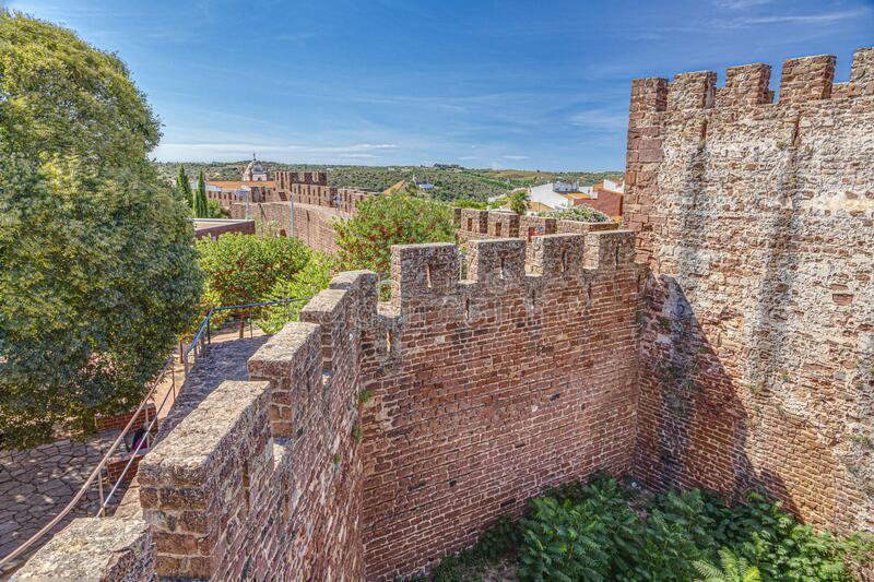 View on impressive external wall of Castelo de Silves in Portugal in summer. View on impressive external wall of Castelo de Silves in Portugal stock photography