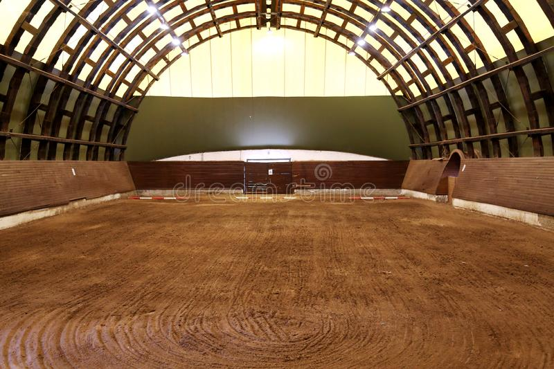 View in an indoor riding hall for horses and riders stock images