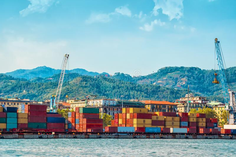 View of the industrial port in La Spezia town, Italy. Many colorful cargo containers for transportation royalty free stock images