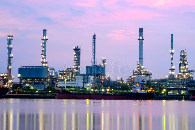 Industry Oil Refinery working in sunrise sky, stock image