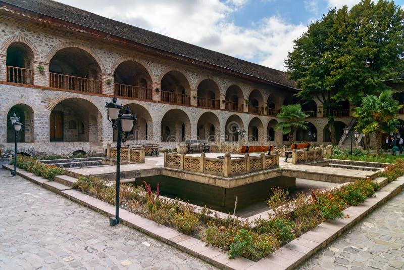 View of the inner courtyard of Upper caravanserai in Sheki. Azerbaijan stock photography