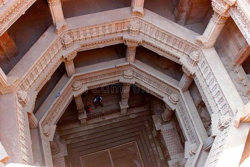 Adalaj Step Well, Ahmedabad, Gujarat, India. View inside the Adalaj step well from the top. Traditional trabeat with horizontal beams and lintels. Adalaj Step royalty free stock photo