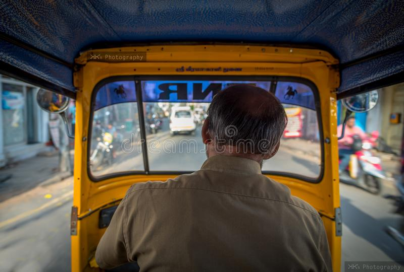 View from the inside of an auto-rickshaw in India,  the Hindu God`s name `Sri Veera Kaali` is written above the windshield. stock image