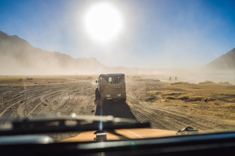 View from inside of an offroad car riding through the so-called Sea of sand inside the Tengger caldera at the Bromo. View from an offroad car riding through the royalty free stock image