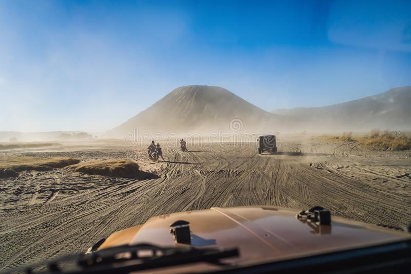 View from inside of an offroad car riding through the so-called Sea of sand inside the Tengger caldera at the Bromo. View from an offroad car riding through the stock photo