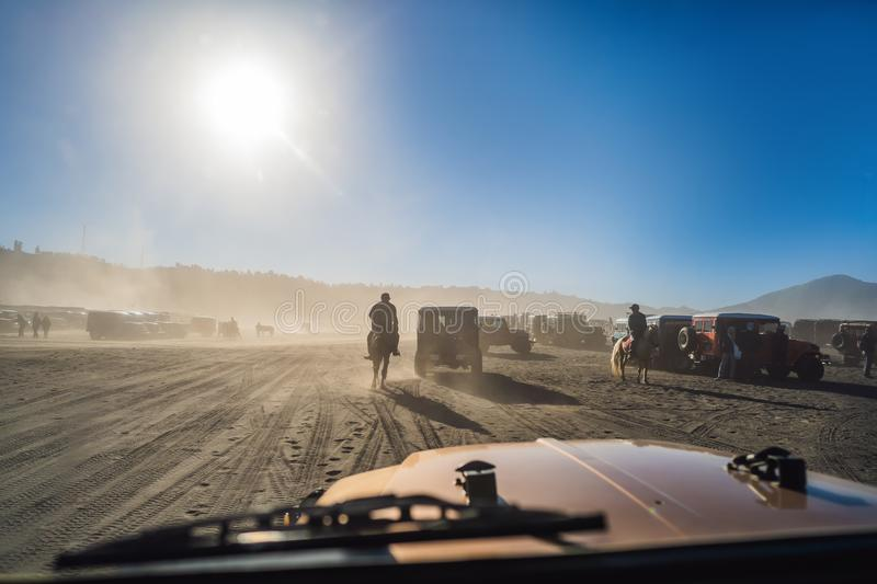View from inside of an offroad car riding through the so-called Sea of sand inside the Tengger caldera at the Bromo. View from an offroad car riding through the stock images